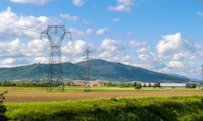 Power transmission line against a Vosges mountains background, Alsace, France